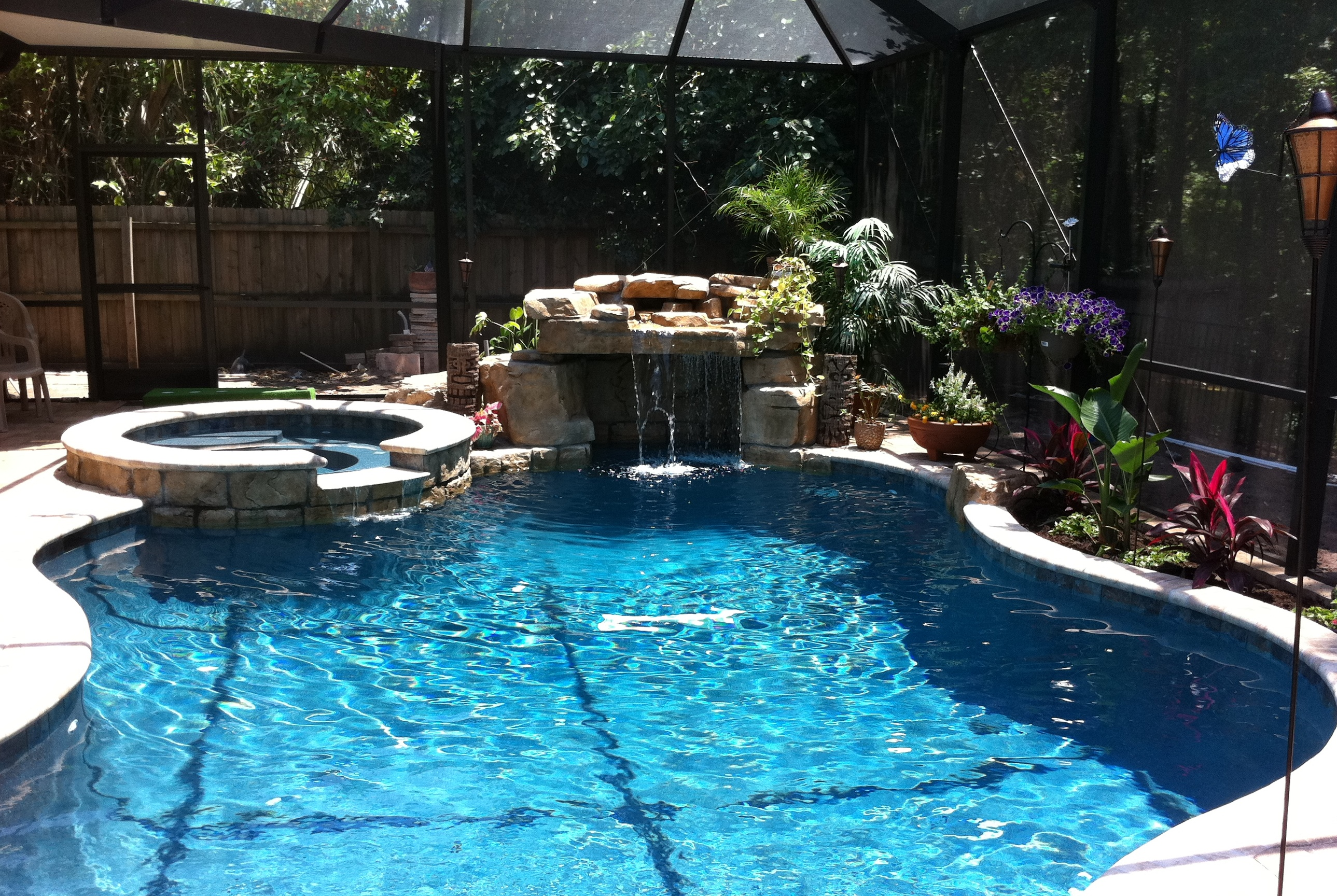 freeform pool with grotto and waterfall