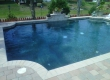 Traditional Geometric Pool with Landscaping