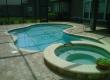 Enclosed Freeform Pool with Raised Spa